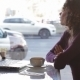 Cute Girl Drinking Coffee On a Cafe In The City - VideoHive Item for Sale