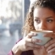 Girl With a Wonderful Smile Drinking Coffee - VideoHive Item for Sale
