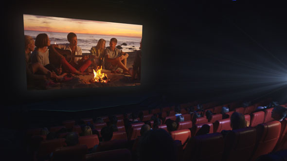 people are watching a drama film screening in a movie theatre by