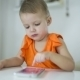 Young Child Plays On A Modern Smartphone In The Interior - VideoHive Item for Sale