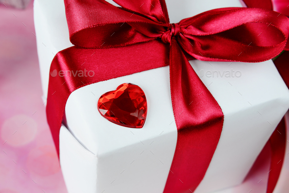 Gift box with a red bow - Stock Photo - Images