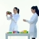 Laboratory Workers Check Quality Of Plastic Toys In White Room - VideoHive Item for Sale