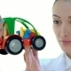 Female Worker Checks The Quality Of Color Plastic Toy Tractor - VideoHive Item for Sale