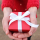 Hands giving a red present - VideoHive Item for Sale