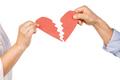 Couple holding broken heart on white background - PhotoDune Item for Sale