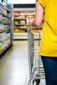 Detail of woman pushing cart in supermarket - PhotoDune Item for Sale