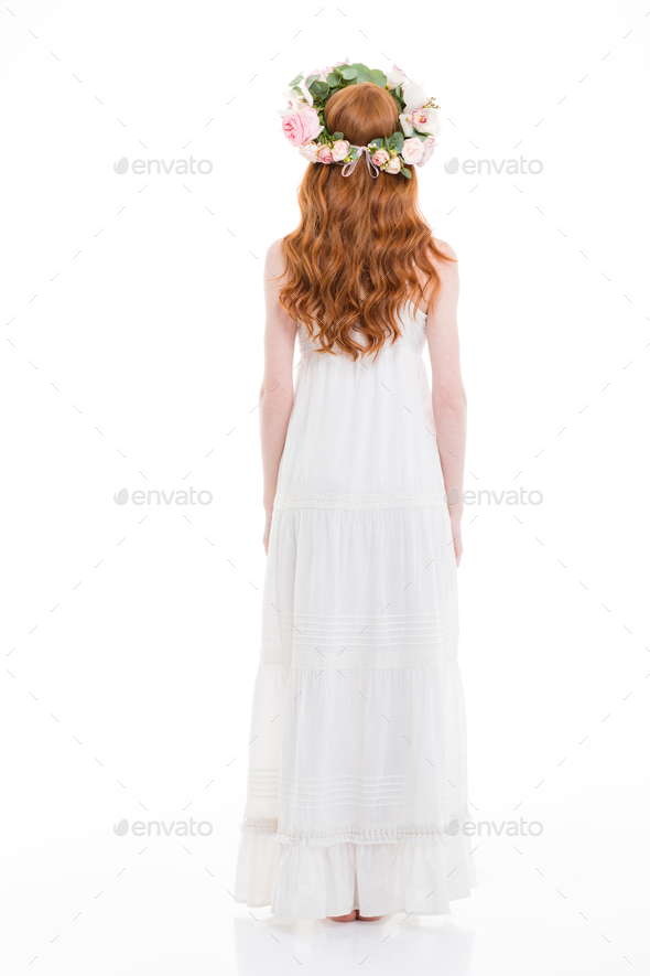 Back view of woman with long hair in flower wreath - Stock Photo - Images