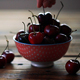 Red Cherries In Bowl On Wooden Table - VideoHive Item for Sale