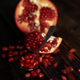 Pomegranate Clusters Falling On Wooden Table - VideoHive Item for Sale