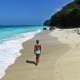 Girl Running On The Beach In Indonesia On Bali In Blue Bikini. Sea View. - VideoHive Item for Sale