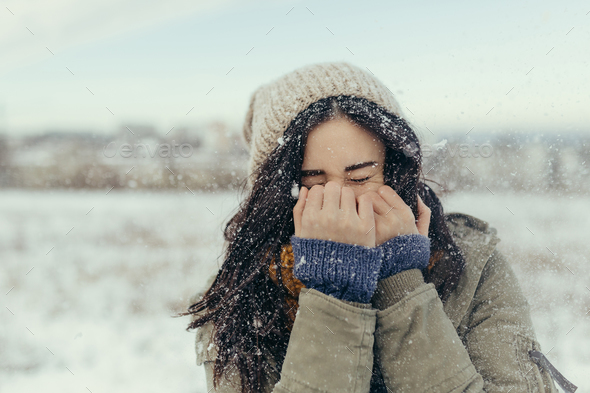 Attractive young woman in wintertime outdoor - Stock Photo - Images