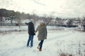 Cheerful young couple walking in a winter day - PhotoDune Item for Sale