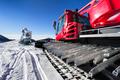 snowmaking gun and snow groomer on ski slopes - PhotoDune Item for Sale