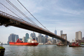 cargo ship and tug boat under brooklyn bridge, New York City - PhotoDune Item for Sale