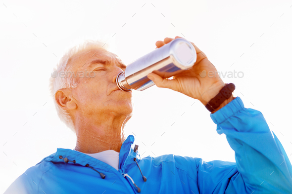 Man drinking from a sports bottle - Stock Photo - Images