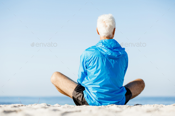 Man training on beach outside - Stock Photo - Images