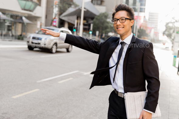 Waving for a taxi in city - Stock Photo - Images
