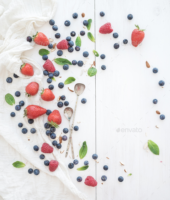 Berry frame with copy space on right. Strawberries, raspberries, blueberries and mint leaves - Stock Photo - Images