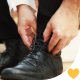 Elegant Man Tying Black Shoes - VideoHive Item for Sale