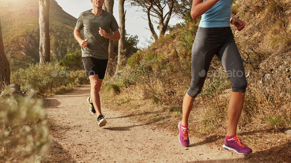 Trail running on a mountain path - Stock Photo - Images