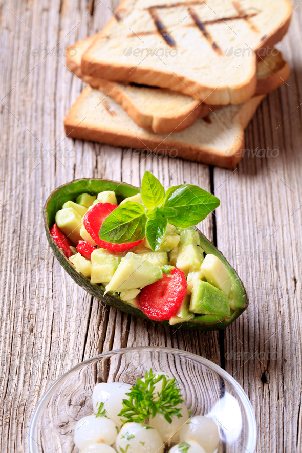 Avocado salad and toasted bread - Stock Photo - Images