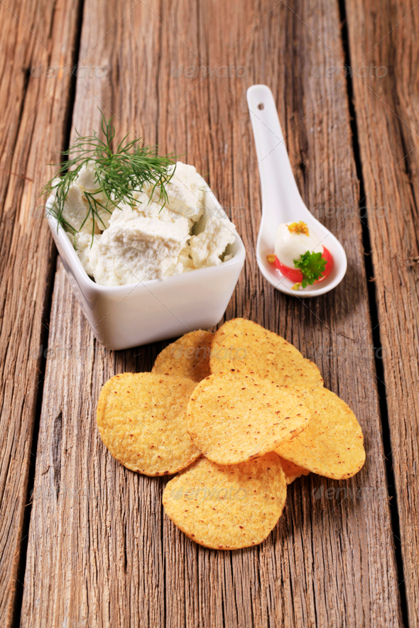 Corn chips and fresh cheese - Stock Photo - Images