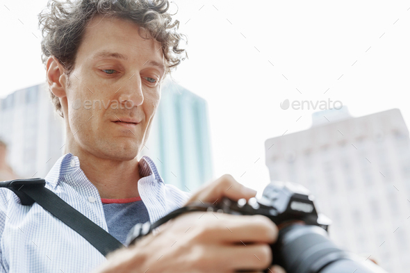 Male photographer taking picture - Stock Photo - Images