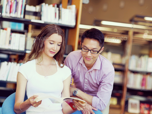 Two young students at the library - Stock Photo - Images