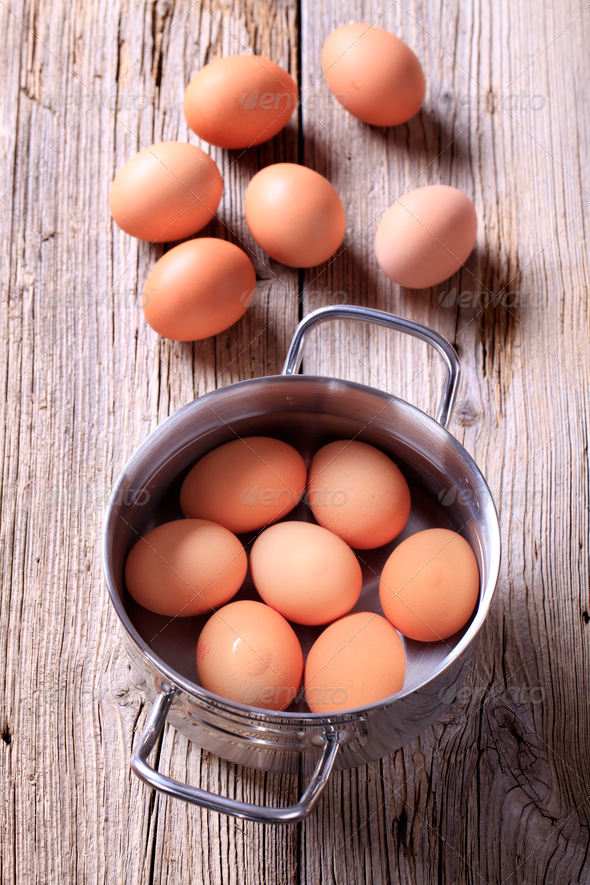 Brown eggs in a pan - Stock Photo - Images