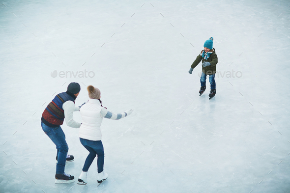 Family on skating rink - Stock Photo - Images