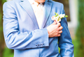 wedding boutonniere on suit of groom
