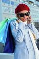 Girl calling during shopping outside
