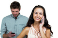 Happy couple using smartphones on white screen