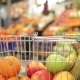 Shopping Cart With Fruit On The Background Of The Market - VideoHive Item for Sale