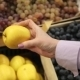 Buyer Selects And Touches The Hands Of Apples On The Market - VideoHive Item for Sale
