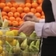 Woman With a Shopping Cart Makes Shopping At Fruit Store - VideoHive Item for Sale