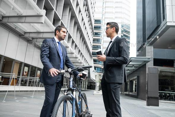 Two businessmen having walk - Stock Photo - Images
