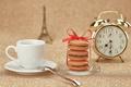 Macarons.Gold alarm clock, cup coffee,Eiffel Tower - PhotoDune Item for Sale