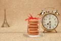 Macarons. Gold stylish alarm clock, Eiffel Tower - PhotoDune Item for Sale