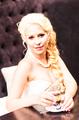 Beauty bride  drinking tea indoors. Beautiful model girl in a white wedding dress