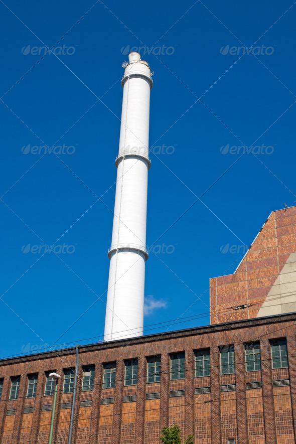 White smokestack and brick building - Stock Photo - Images