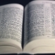 The Bible On a Black Background. Turning The Pages Of The Holy Scriptures. - VideoHive Item for Sale