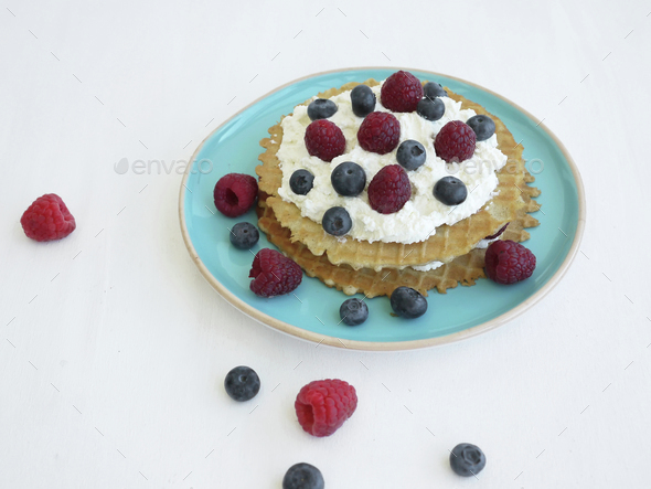 Waffels with sweet ricotta and fresh berries - Stock Photo - Images