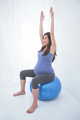 Beautiful asian pregnant woman doing exercise with a swiss ball,