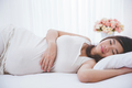 Beautiful pregnant asian woman sleeping peacefully