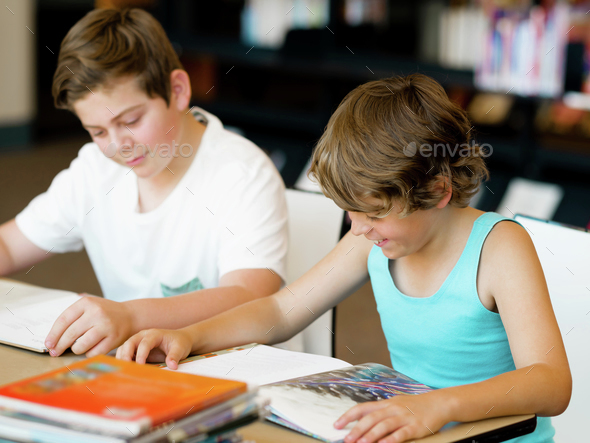 Two boys in library - Stock Photo - Images