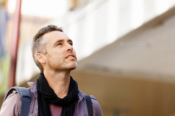 Male tourist in city - Stock Photo - Images