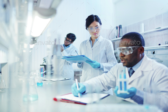 Working in laboratory - Stock Photo - Images