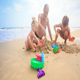 Grandpa Kids Build Sand Castle on Beach by Wave Surf - VideoHive Item for Sale
