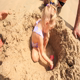 Grandpa and Kids Play among Sand Heap on Beach - VideoHive Item for Sale